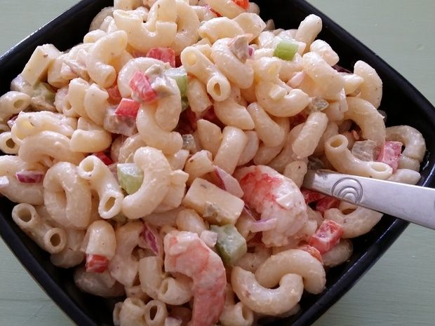 This is our familys favorite ever.  It started originally with a Justin Wilson recipe that weve modified over the years.  It has just the right amount of zing - not your mamas macaroni salad!