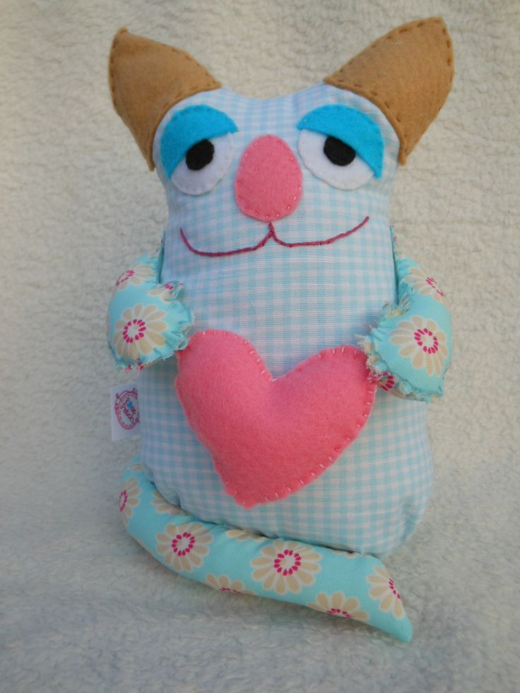 Another doorstop kitty in turquoise blues.