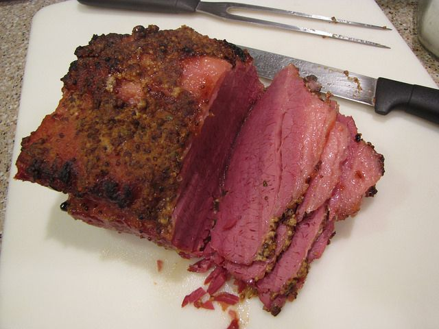 The Best Baked Corned Beef - tender, flavorful, and so easy to make. A quick mustard brown sugar topping adds great flavor and offsets the saltiness of the meat.