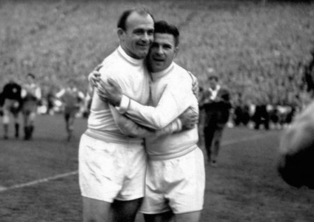 Alfredo Di Stefano and Ferenc Puskas hug it out...