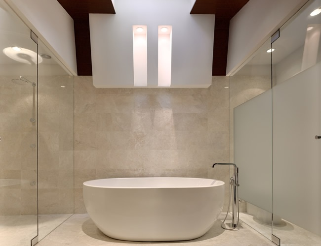 a midcentury glass and frameless shower enclosure install we did on a brown