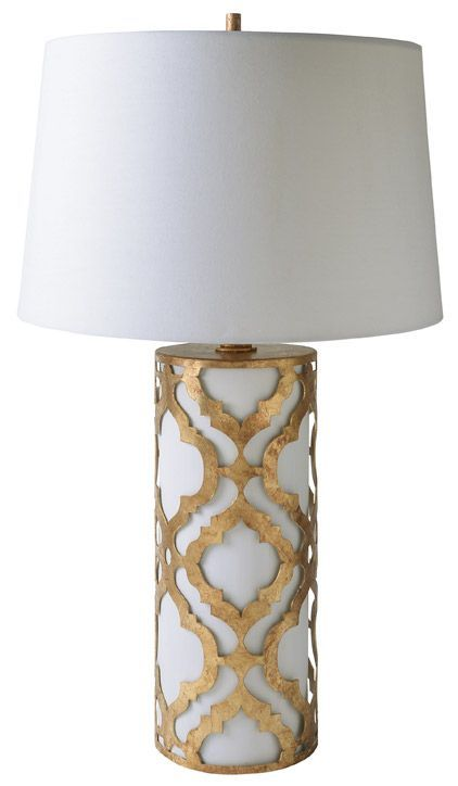 Gilded Nola TLM1015 Arabella Table Lamp.  The pattern cut out of metal responds to the ongoing quatrefoil trend while still keeping a timeless appearance with a Classic Cream and Glazed Gilt Finish.