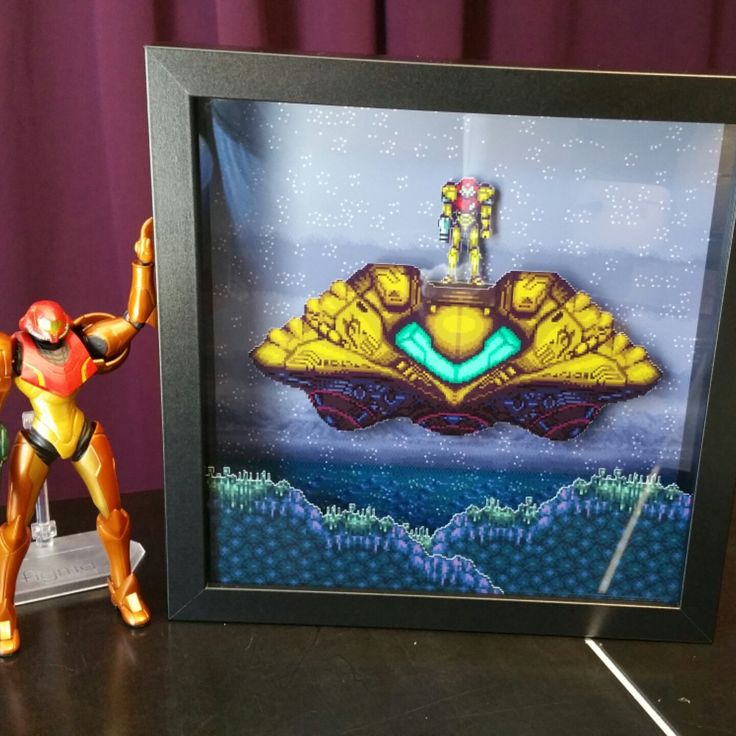 Samus remembering the good old days with our new 9x9 Super Metroid shadow box!