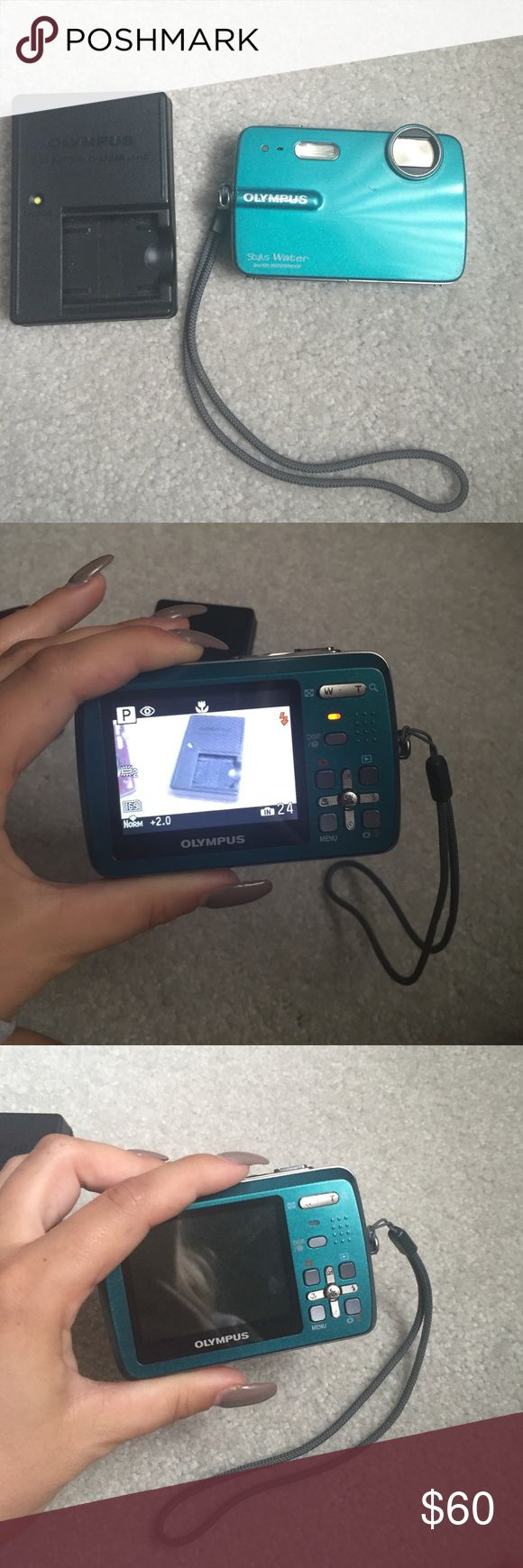 Olympus underwater camera incl: charger & battery Olympus teal underwater camera includes charger and battery Other
