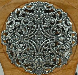 close up of Silver Filigree Travel Wheel--$2195