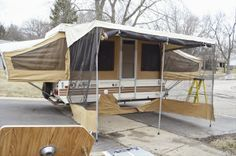 something wilde: Pop Up Camper - Part 1 - demo, small roof repair, remove cabinets, painted walls, new flooring