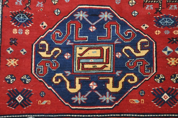 ORIENTAL CARPET FROM THE KARABAH REGION OF ARMENIAThis luxurious woolen rug has a pleasing, traditional design and was handmade. It is a unique piece and should appeal to both the experienced collector and the first-time buyer. This carpet is 70 years old and was woven in Armenia in the Southern Caucasus. It has three motifs which include a number of snakes.  The motif of the snake is closely connected to that of the tree of life, since the snake is often depicted as the guardian of the…