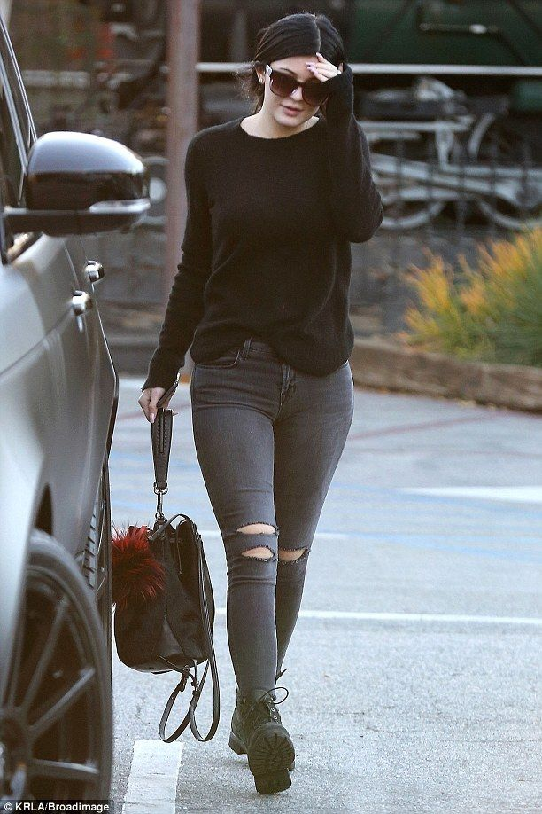 Kylie Jenner wearing Fendi Buggies Keychain, J Brand 8226 Photo Ready Cropped Jeans in Mercy, Elizabeth and James Cynnie Sling Bag and Timberland Classic Boot in Black