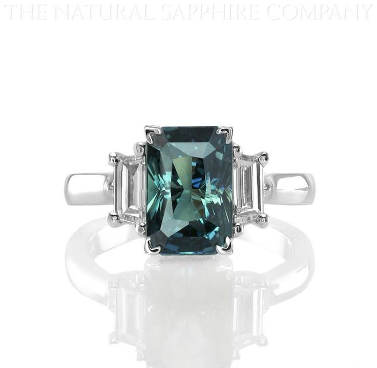 This is THE ring. Love the slight rectangular shape, the color (gotta be a Montana saphire), the diamond bling, the white gold. Could be cut for a little more sparkle? Love the modern design! http://www.thenaturalsapphirecompany.com/Blog/wp-content/uploads/2011/10/Blue-Green-Sapphire-and-Diamond-Three-Stone-Ring.jpg