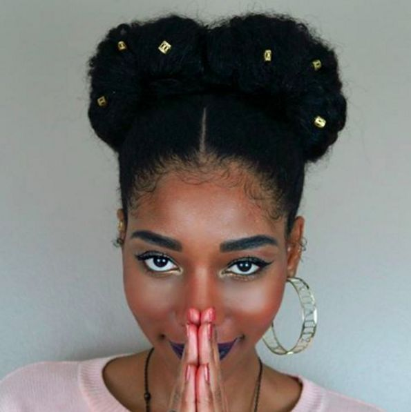 Kahlo is shining her goddess light on these Frida buns. | 15 Easy Protective Styles You Can Do Even If You Suck At Hair. First make two high pigtails, and then make each one into a fan bun. Add a few loc cuffs to give it something extra.