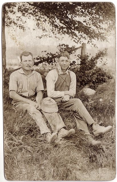 Two field workers with pipes