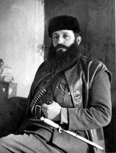 Aris Velouchiotis, a communist chieftain in the mountains of Greece, poses during the Nazi occupation. A journalist in civilian life, Aris was the leader of the Black Berets, communist thugs with a long string of atrocities to their credit. Note the ceremonial dagger carried by Greek Army cadets for the duration of their studies at the Military Academy. Aris apparently liked the visual effect.