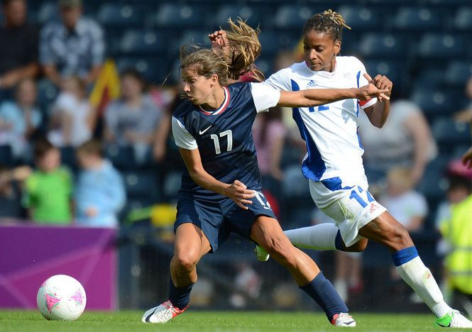 Tobin Heath and forward Elodie Thomis of France, July 25, 2012. (Matt Kryger/USA TODAY Sports)
