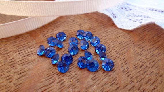 Antique loose foiled back blue glass stones sold individually. These are foiled backed however due to their age there is wear and scratching to the