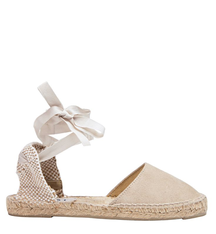 "Manebi's espadrilles are designed with a ""passion for summer"" and travel in mind. Set on the brand's signature jute soles, this handmade Hamptons pair of espadrilles has a champagne beige suede toe, cutout sides and platform sole. Lace up the ankle ties and team them with everything from j"