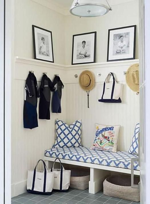 Just add framed art to change your mudroom into a gallery! Love how they are leaning on the ledge too.