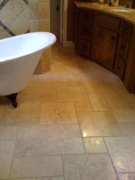 Versaile chiseled edge travertine on bathroom floor