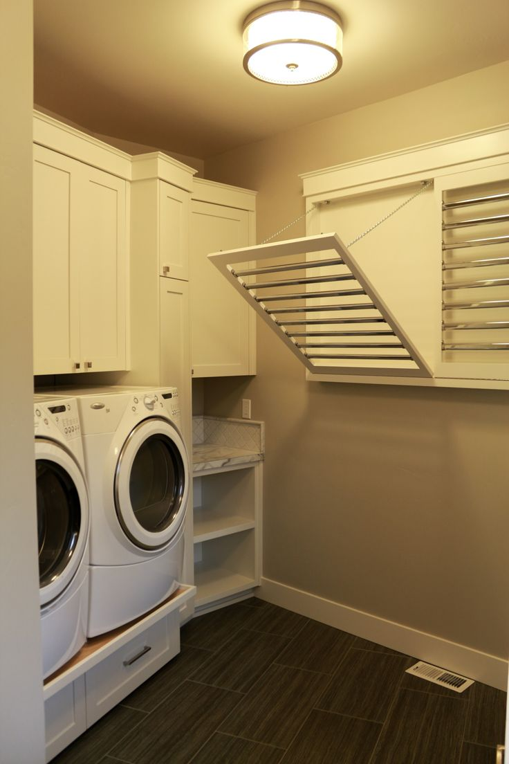 North Idaho Living, Pacific Northwest, Inland Northwest, Laundry room, built in drying racks, White cabinets