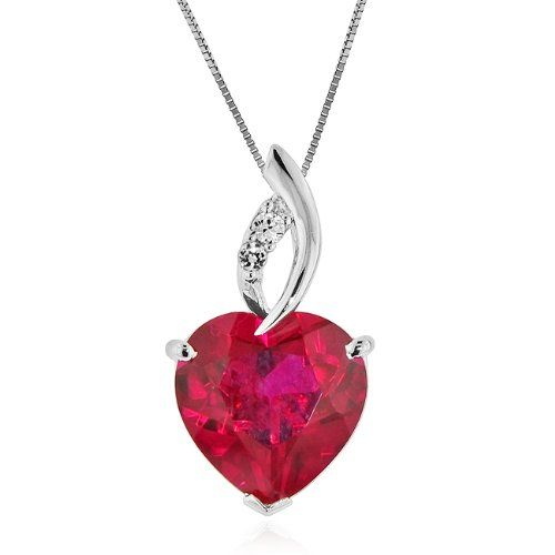 the silver makes the ruby look so much more grand. and the complimentary diamonds make it look so beautiful
