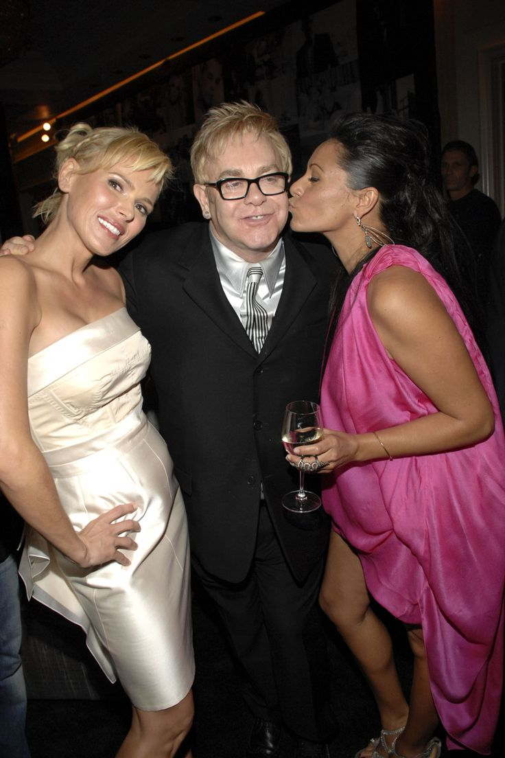 Diana Jenkins, Sir Elton John and Deborah Anderson at the book launch party for Room 23 at the Peninsula hotel