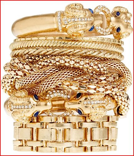Stacking multiple gold bangles
