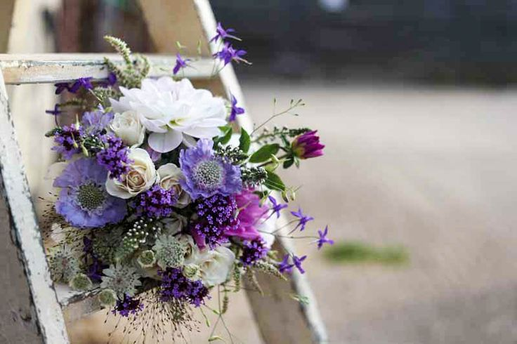 Bridesmaids bouquet of dahlias, scabious, astrantia, larkspur, mint and verbena. by G&G