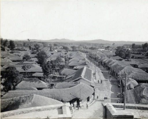 Suwon (수원시): Street scene. This photo is taken from the upper story of the South Gate, overlooking the main street. Circa 1920