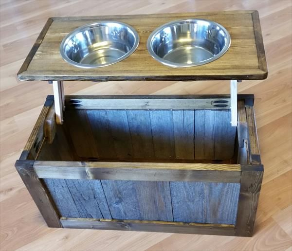 DIY Pallet Raised Dog Feeder with Storage | I LOVE the idea, but I don't like the palet look so much. The storage could work wonderfully to store Knight's toys & treats. ~Ser
