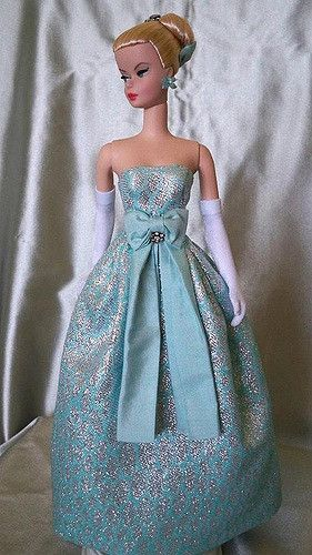 OOAK Silkstone design by Matthew Sutton Restyled, repainted, all clothing and jewelry designed and created by me! ^_^ Aqua and silver silk brocade gown with aqua silk accent bow and sash, crystal brooch detail at bow mattsutton.com