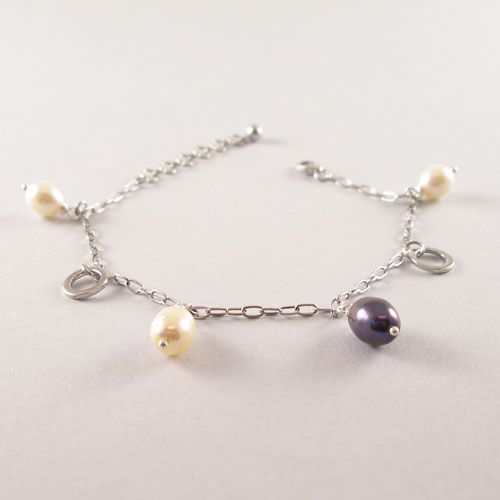 Dangling freshwater pearl bracelet made with 925 Sterling Silver.