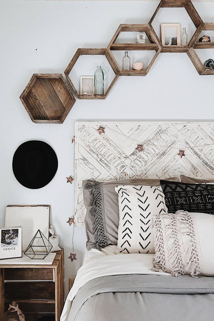 Hexagon shelves that double as a headboard design.