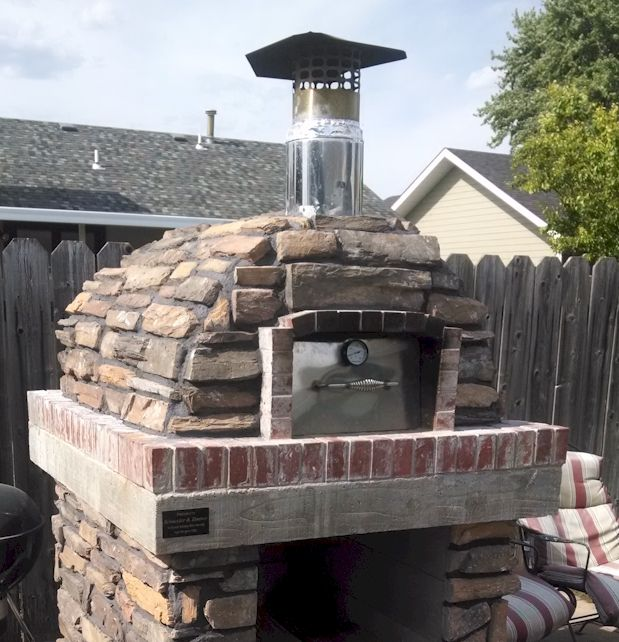 Stone Veneer on the Pizza Oven with matching Stone Veneer on the Pizza Oven base.   Nice match with a custom made door.  BrickWoodOvens.com