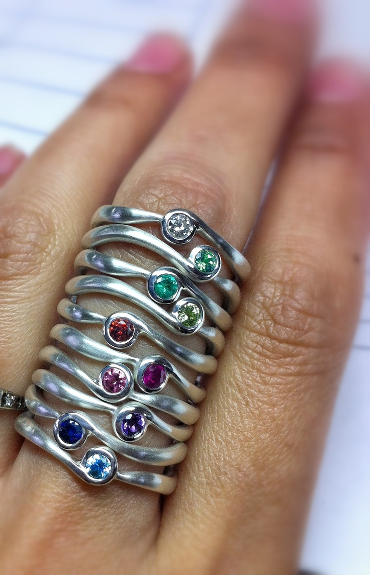 Matsu Jewellery- sterling silver and gemstone rings. I wish my fingers were long enough to wear this many!  Fabulous way to wear a family ring