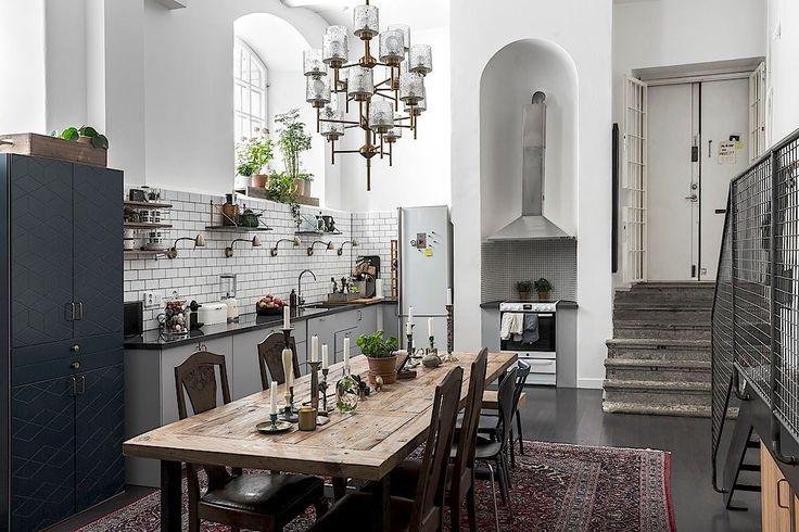 high ceiling kitchen white walls dark floor table carpet staircase kitchen furniture