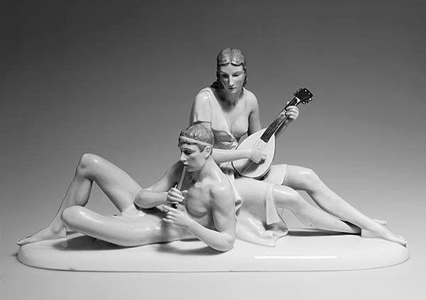 Gerhard Schliepstein. 'Music', 1937. H. 24.5 cm; 46.5 x 14 cm. Made by Rosenthal, Selb, 1939. Porcelain, white, glazed, overglaze in pink, light-blue, brown and green. Marked: G. Sch., maker's mark, original adhesive label, 1631.
