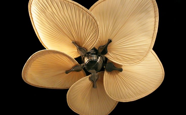 The Islander has been a staple in tropical ceiling fans for over 20 years. This beauty from Fanimation is commonly paired with woven bamboo or natural palm frond blades (pictured) to accentuate its tropical theme. http://www.ceilingfan.com/Fanimation-Islander-Ceiling-Fan-p/fmmad3250ab.htm
