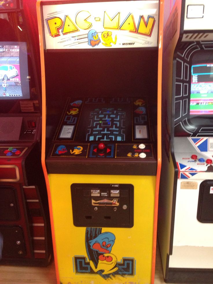 PAC-man arcade machine. I'm not sure if this is an original pacman or a remake. But it certainly looks original. These were very popular in the 70s and 80s. The usually were controlled by 2 or 3 round buttons and a joystick. And coin operated.