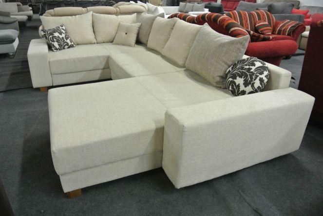 New Haag U-form ülőgarnitúra: Balos kivitelű, U alakú ülőgarnitúra, bézs színű szövet bevonattal, sok párnával.