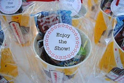 Movie favors - cute idea if we do a Movie Night at our rehearsal dinner.