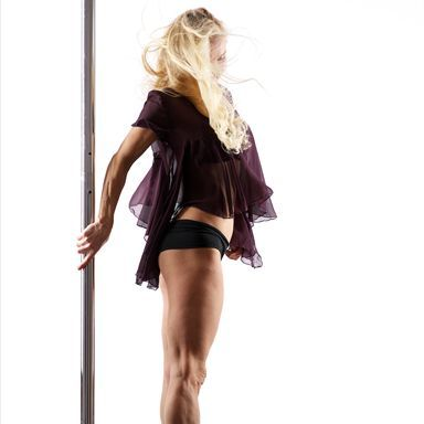 Certified pole fitness instructor Sabine Dworak-de Vries demonstrates the basic warmup moves that should be done before any pole fitness class to improve flexibility, strengthen key muscles, and