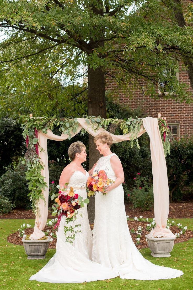 Autumn Colored Wedding in North Carolina- colorful bouquets- greenery altar- same sex wedding