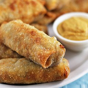 Pork Egg Rolls REVIEW:  Made these tonight, and was surprised at how easy they were!!  I dumped in some red chili flakes, and they spiced up nicely..  will definitely add these to our menu.. and will try baking them next time, too!!