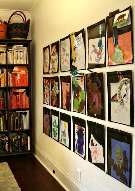 Wondering how to display your child's art? Try this awesome idea #homeschool, #art, #kids -use plastic envelope sheaths