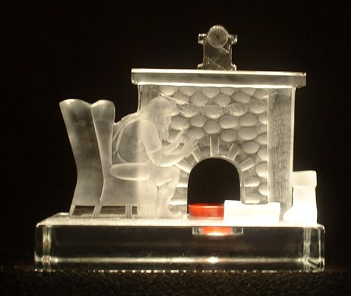 Santa by the fire - sculpted and engraved by G.Sullivan
