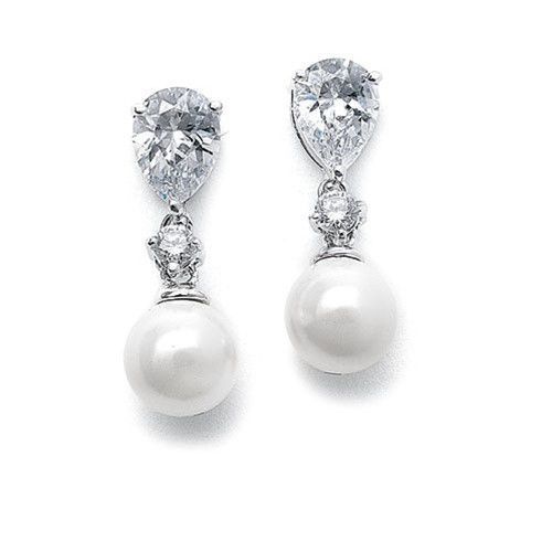 These earring feature a classic pearl and CZ design featuring an 8mm white pearl drop with a pear shaped cubic zirconia top. These popular earrings make an elegant bridal or bridesmaid earring at a gr
