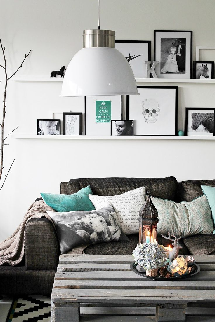 Love the black/white/gray monochromatic scheme, but then there's that pop of turqoise...this would be an easy change to my bedroom in I get tired of the purple!