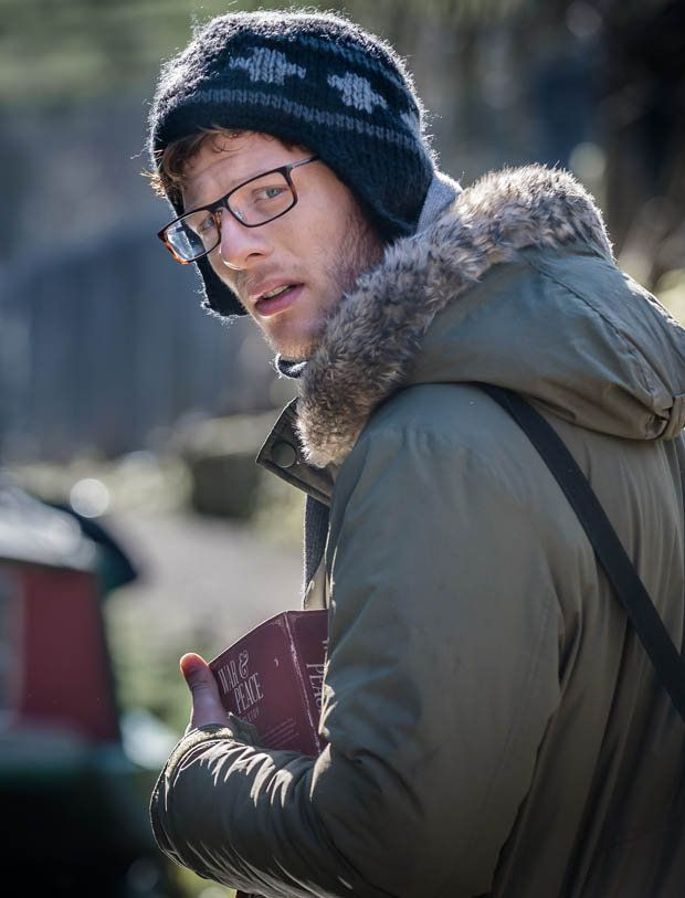 "James Norton. Scary as hell in Happy Valley.  AND, I think it's GREAT he's carrying a copy of ""War & Peace"" - before the miniseries came out!"