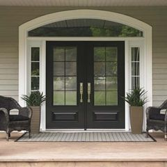 Painted front door.  White trim.  Planters in front of side panels.  Chairs next to them.