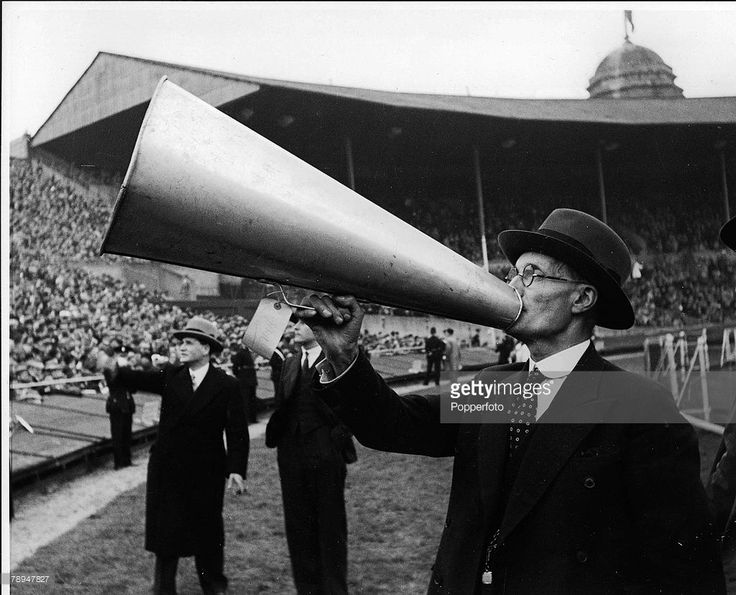 Volume 2, Page 111, Pic 1, Football, FA Cup Final, Wembley Stadium, London, 25th April 1936, Arsenal 1 v Sheffield United 0, A Wembley official speaks into a megaphone at the Cup Final