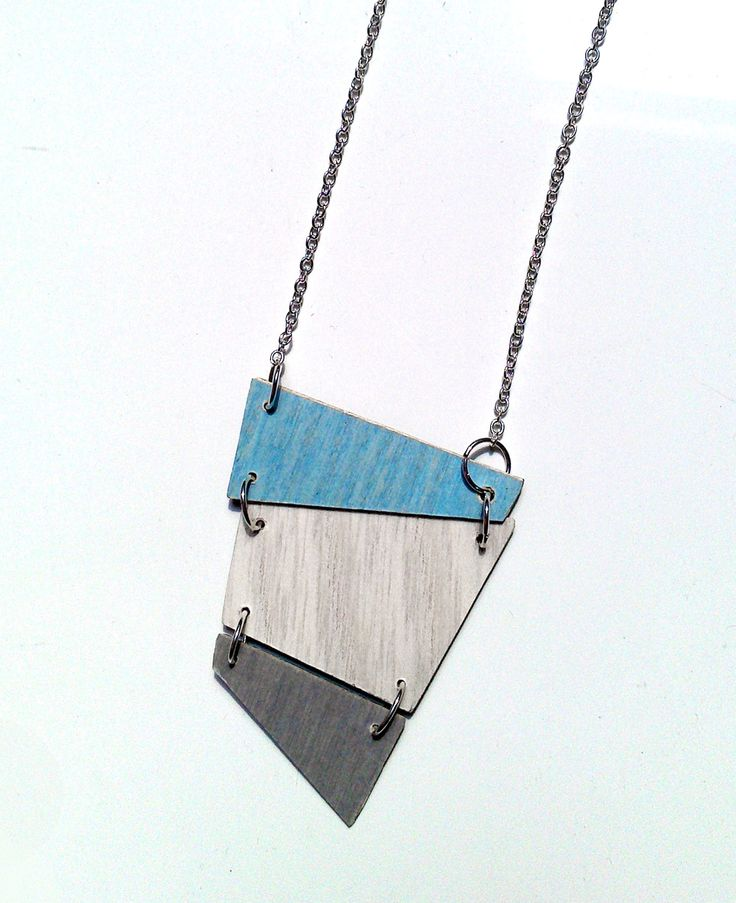 Geometric pendant from wood surface finishing samples